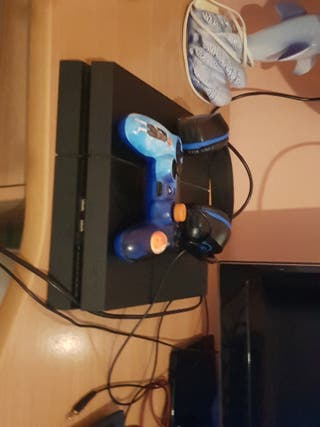 play 4 con mando y cascos gaming