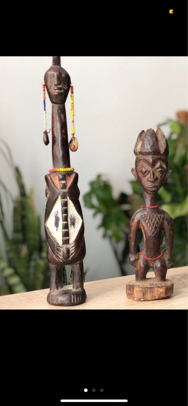 Lote de 2 figuras africanas