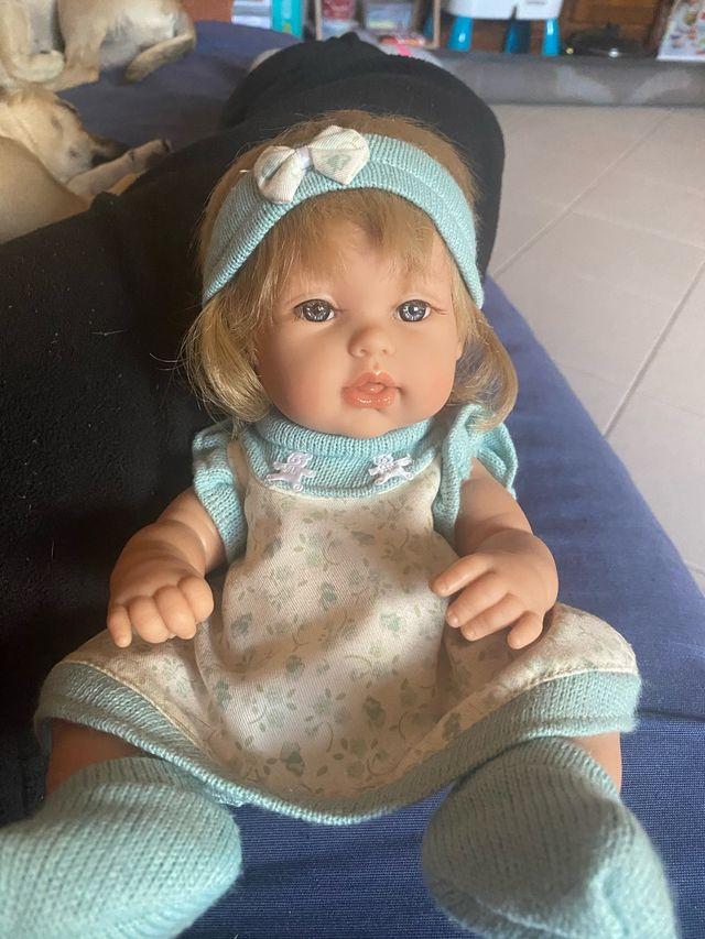 Muñeca arias