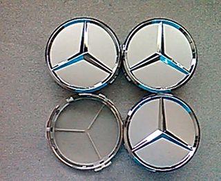 Tapabuje centro rueda Mercedes plata clasico 75mm.