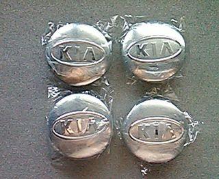 Tapabujes centro de ruedas Kia gris 58mm.
