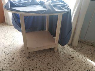 Mesa camilla redonda.