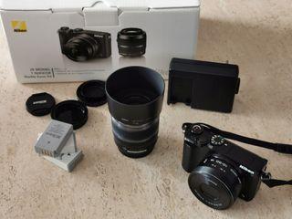 Cámara Evil Nikon 1 J5 con 2 objetivos