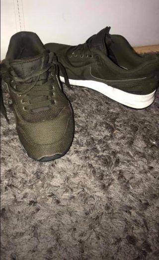 Green Nike trainers