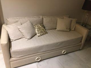 Sofá con dos camas