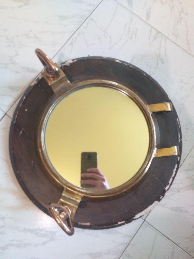 Ojo de buey barco con espejo incrustado en madera