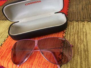 Gafas de sol rosa de mujer. Carrera