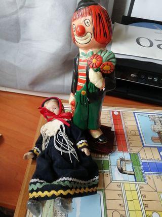 muñeca diabólica y payaso come niños