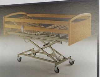 Cama geriátrica eléctrica con colchón.