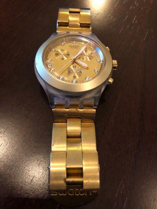 Reloj swatch Swiss dorado