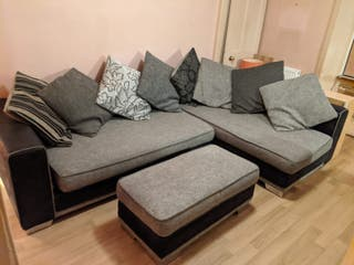Comfortable corner sofa with cushions & footstool