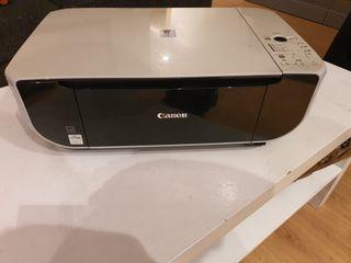 Impresora canon con cartucho de tinta en uso.