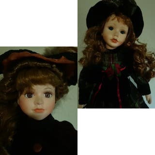 2 muñecas de porcelana 50 cm de alto.