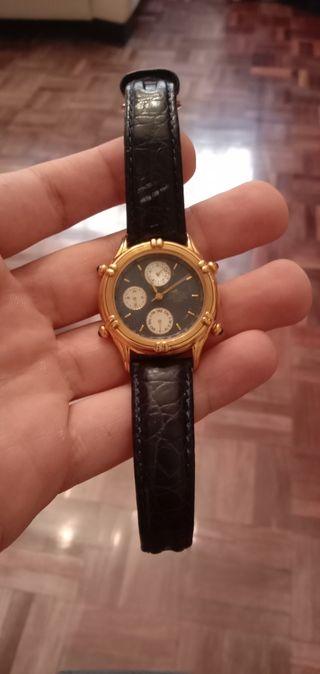 Reloj Lotus de oro y cuero