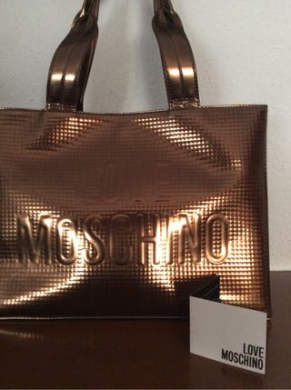 Bolso MOSCHINO color cobre . oferta