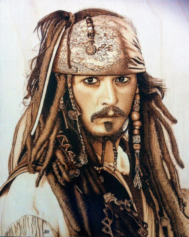 Cuadro pirograbado de los piratas del caribe.