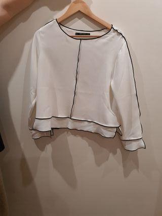 Camisa.