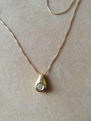 Cadena y colgante en oro y diamante