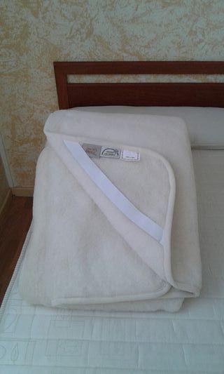 Cubre-colchón de lana.