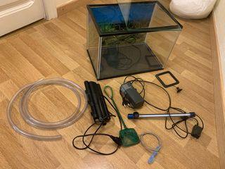 Aquario Pecera tortuguera con accesorios.