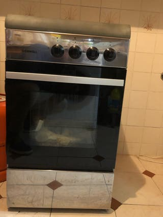 Cocina tres hornillas a gas y horno