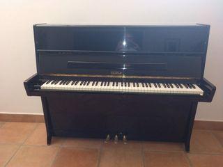 Piano Petrof perfectas condiciones.