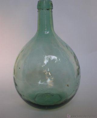 8 botellas redondas de cristal soplado