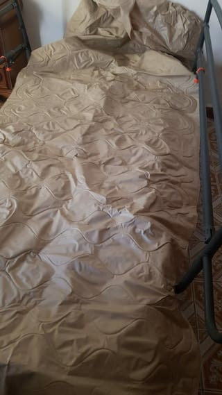 Cama articulada y colchón anti llagas
