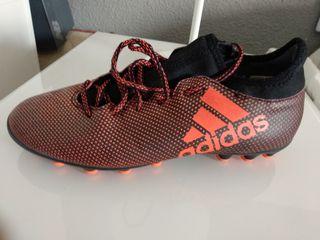 botas fútbol tacos