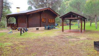 Cenador o casa de madera pergola