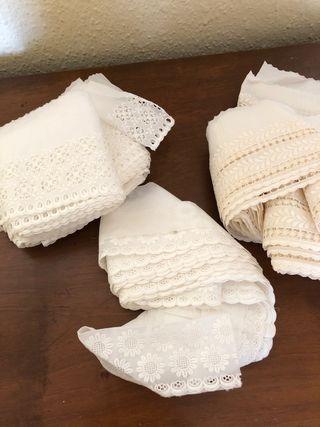 Sábanas y tira bordada para coser
