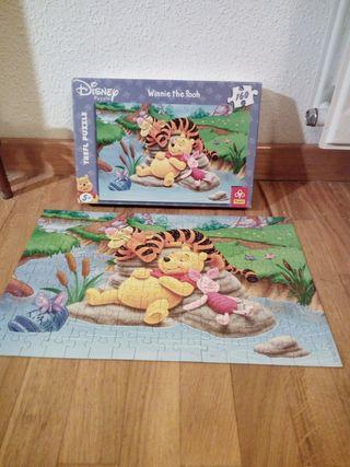 Tres puzzles de 160 piezas de Winnie de Pooh.
