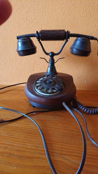 réplica de teléfono antiguo funcionando