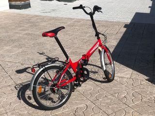 Bicicleta plegable roja, poco uso.