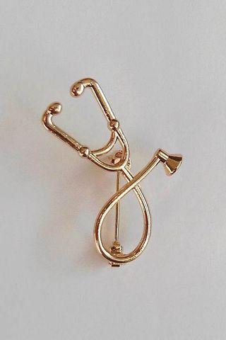 Broche de estetoscopio dorado