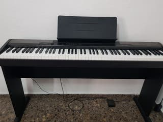 Piano electrónico Casio CDP-100 con soporte