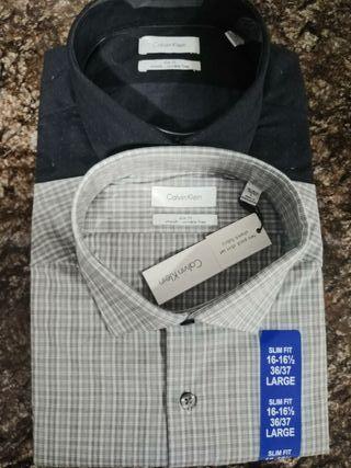 dos camisas C.Klein L slim fit