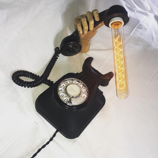 Lámpara de pared teléfono negro antiguo