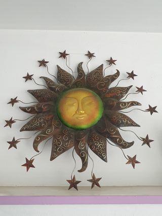 figura sol y estrellas