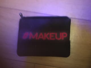 Coat shoes makeup bag,hairspray