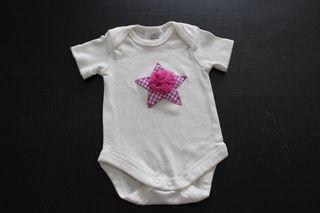 Body de bebé de manga corta. Nuevo