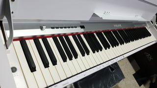 PIANO DIGITAL NUX WK310 CON MUEBLE Y PEDALERA (NUE