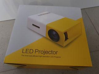 Mini proyector LED YG300 con batería integrada
