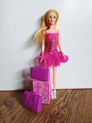 Barbie y maletas