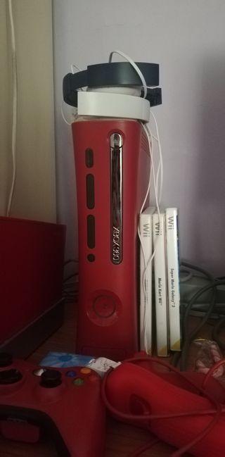 vendo xbox roja con un mando inalambrico.