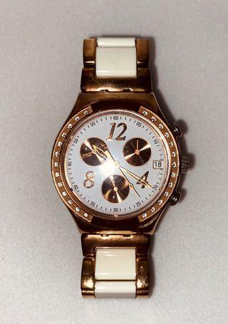 Reloj Acero Swatch.