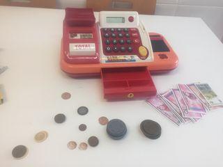 Caja registradora, calculadora y monedas