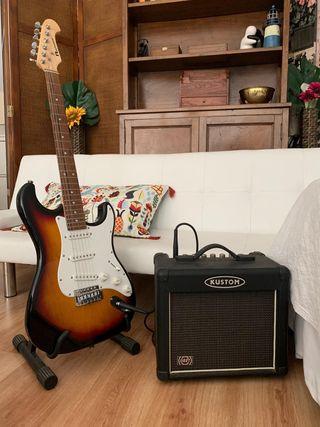 Guitarra eléctrica, amplificador y soporte