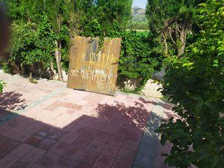 portón abatible con Pilar de anclaje
