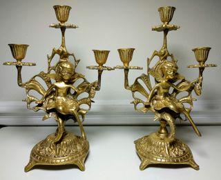 Pareja de candelabros antiguos de bronce